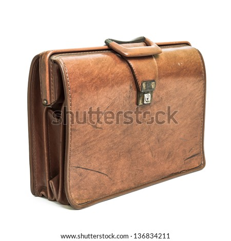 Old tan leather briefcase isolated on a white background.
