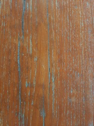 Old teak floors where the wood glaze has partially slipped off to reveal the original wood grain pattern.