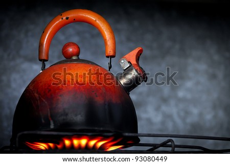 Old teapot on a gas cooker