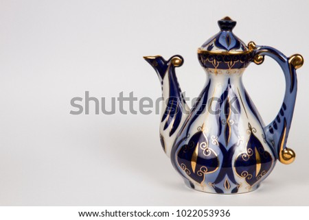 old teapot with Asian blue pattern #1022053936