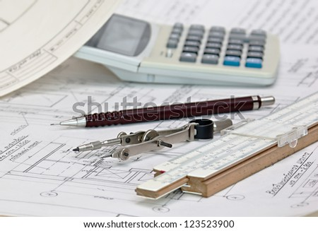 old technical drawings and slide rule - stock photo