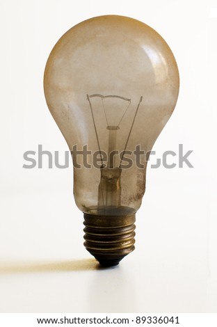Old technology and wasting electricity, burned out light bulb - no idea concept