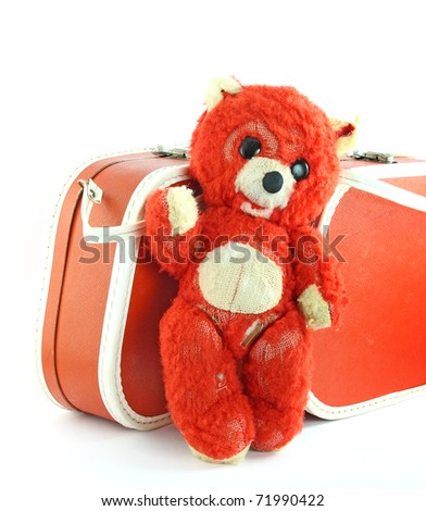 Old teddy bear and suitcase