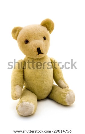 Old teddy bear on a white background