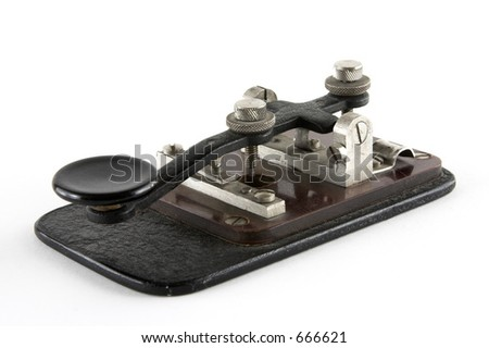 Old telegraph key over white background