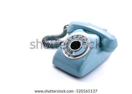 Old telephone on white background #520565137