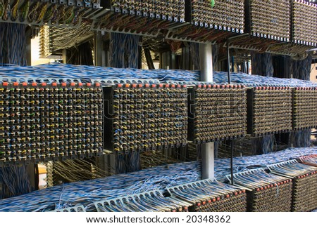 old telephone switchboard with wires of white and dark blue colors