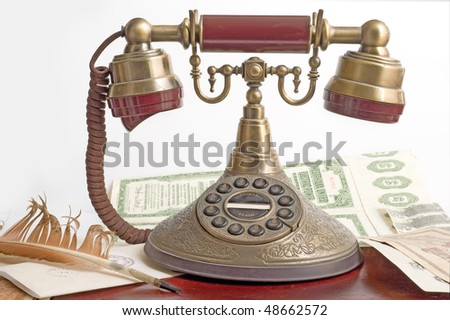 old telephone with money ,feather and letter