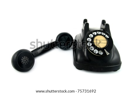 old telephone with rotary dial isolated on white background