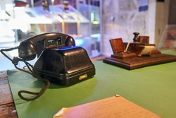 Old telephone without the dialer on the desk