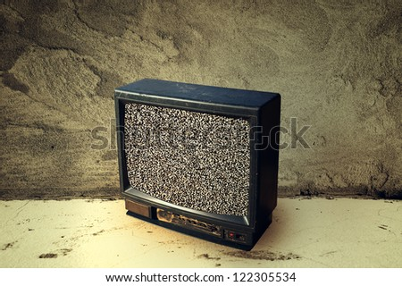 Old television in the room with no tv signal