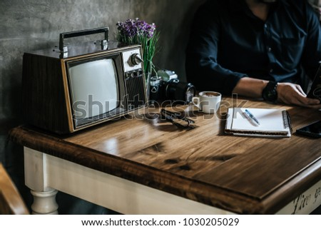 Old television on wooden table decorated in coffee shop,Retro TV technology