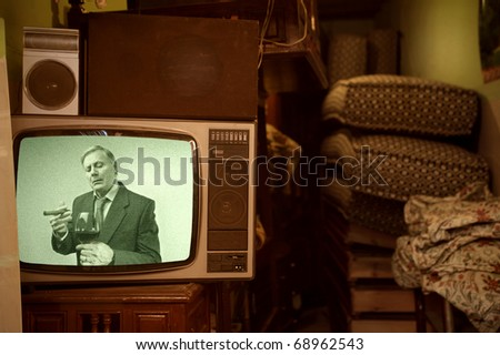 Old television showing a senior gentleman