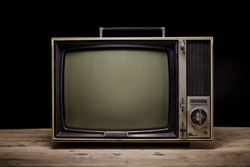 Old television vintage on wooden with black background, Retro, vintage TV style