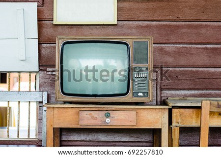Old television, wood table and wood chair with wood wall, Thailand #692257810