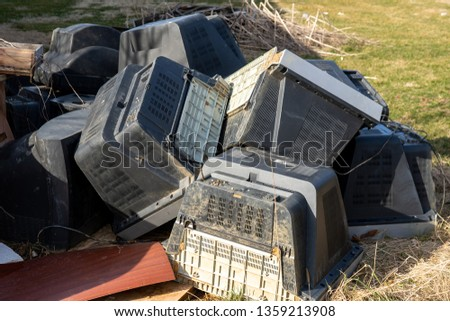 Old televisions laying out ready for disposal #1359213908