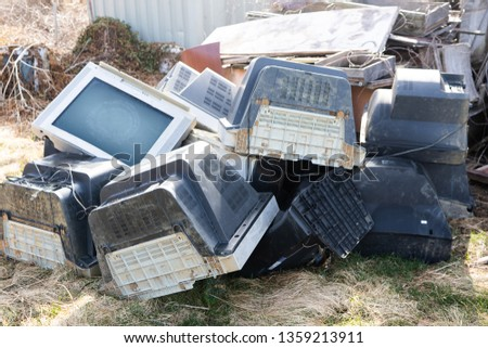 Old televisions laying out ready for disposal #1359213911