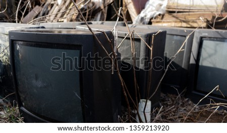 Old televisions laying out ready for disposal #1359213920