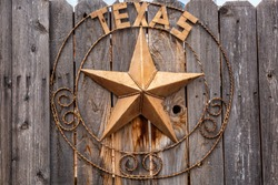Old Texas star sign on wooden fence near Moab Utah, USA.
