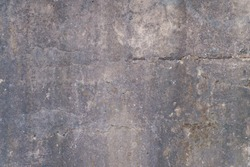 Old textured concrete wall with metal reinforcement. Background