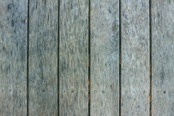 Old textured discoloured wooden boards Old textured discoloured wooden boards arranged vertically.