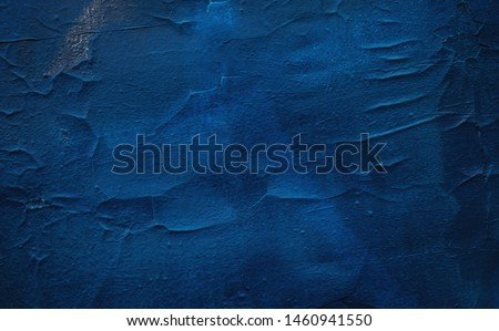 Old textured iron door painted in deep blue color