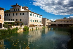 Old thermal baths in the medieval village Bagno Vignoni, Tuscany, Italy