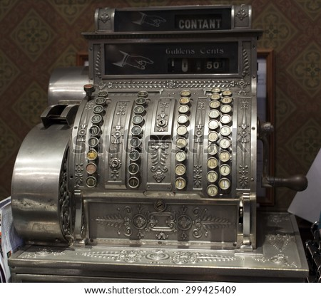 Old-time cash register in a shop. #299425409