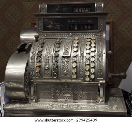 Old-time cash register in a shop. #299425409