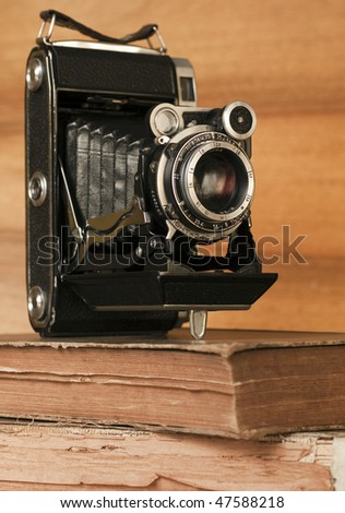 Old-time  photo-camera on wood background