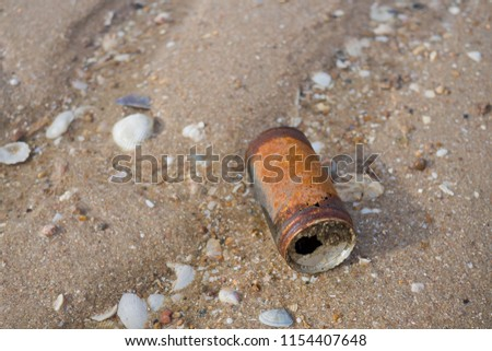 old tin can on the beach, dirty sea, recycle, rust can