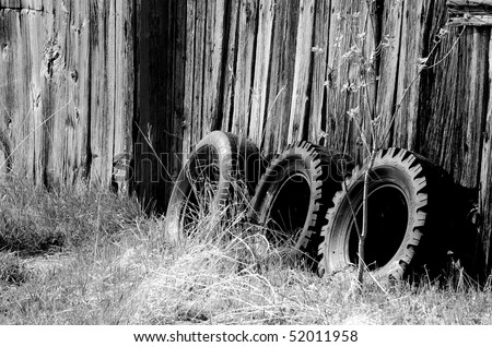 Old tires and barn in black & white