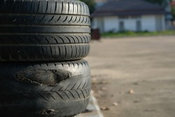 Old tires stacked, Close-up Broken tire damaged, A bunch of old tires from used cars. Environmental pollution. Dump tires