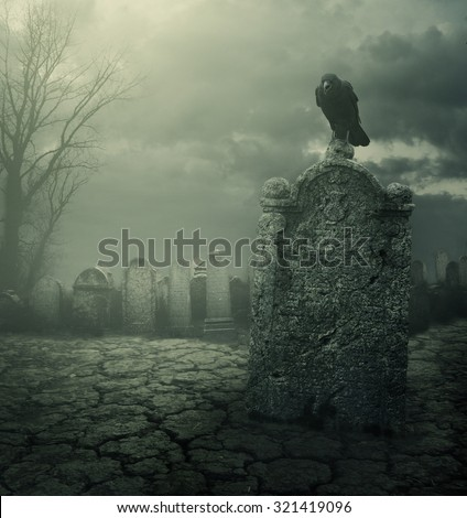 old tombstone with scary crow...