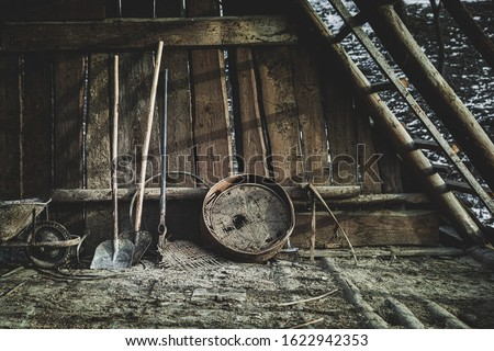 Old tools in an old house, old wooden cottage.