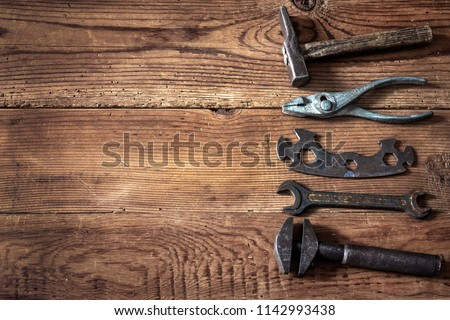 old tools on wooden background #1142993438