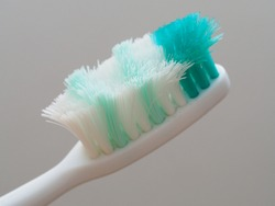 Old toothbrush with frayed bristles in close-up view:  time to change a new toothbrush for oral health