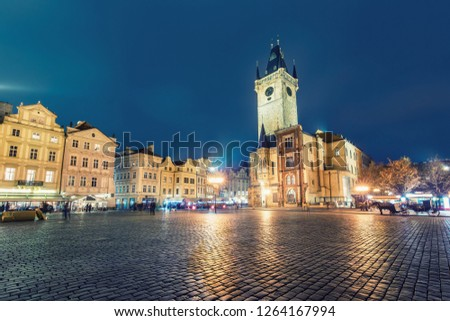 Old town hall tower in Prague, Czech republic, at night. Colourful skyline.