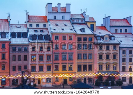 Old Town Market Place with colorful houses during morning blue hour, Warsaw, Poland. #1042848778