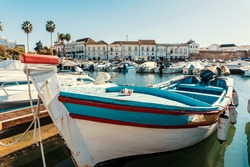 Old town of Faro with traditional wooden boat moored in marina, Algarve, Portugal