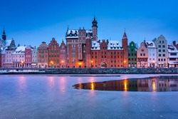 Old town of Gdansk over Motlawa river at snowy dawn. Poland
