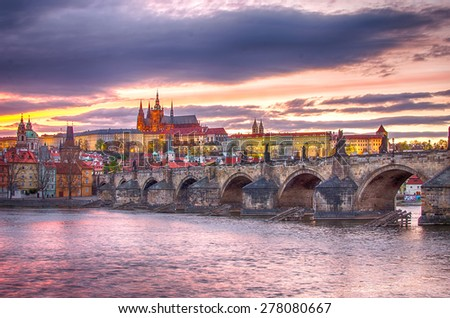 Old Town of Prague (Czech Republic) in sunset. Skyline with Charles (Karluv) Bridge and Vltava River. Castle (Hrad) of Prague in the background. Picture represents main landmarks of spectacular city.