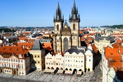 Old Town of Prague, Czech Republic. View on Tynsky Temple on the Staromestska square as seen from Old Town City Hall. Blue sunny sky.
