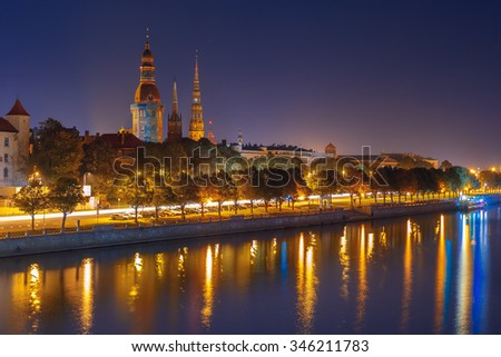 Old Town of Riga and River Daugava at night, Riga Cathedral and Saint Peter church, Railway Bridge and Riga Radio and TV Tower in the background, Latvia