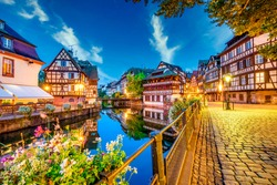 Old town water canal of Strasbourg, Alsace, France. Traditional half timbered houses of Petite France