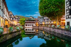 Old town water canal of Strasbourg, Alsace, France. Traditional half timbered houses of Petite France at dawn