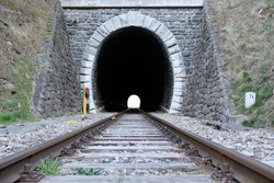 Old tracks through a tunnel