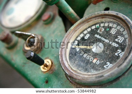 Old tractor dashboard with a key in the ignition