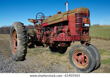 Old Gibson Tractors http://www.shutterstock.com/pic-65405965/stock-photo-old-tractor-for-sale-an-old-tractor-seeks-a-new-owner.html