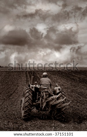 Old tractor ploughing a field